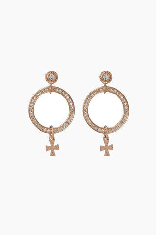 LUV AJ The Moroccan Pave Loop Studs - Rose Gold Jewelry | Rose Gold| Luv Aj The Moroccan Pave Loop Studs - Rose Gold. Features:  Pair of circular pave loop studs with hanging cross charm detail Posts are made from surgical steel so they are very hypo-allergenic Made from Brass and Swarvoski Crystals  Plated in Gold Front View