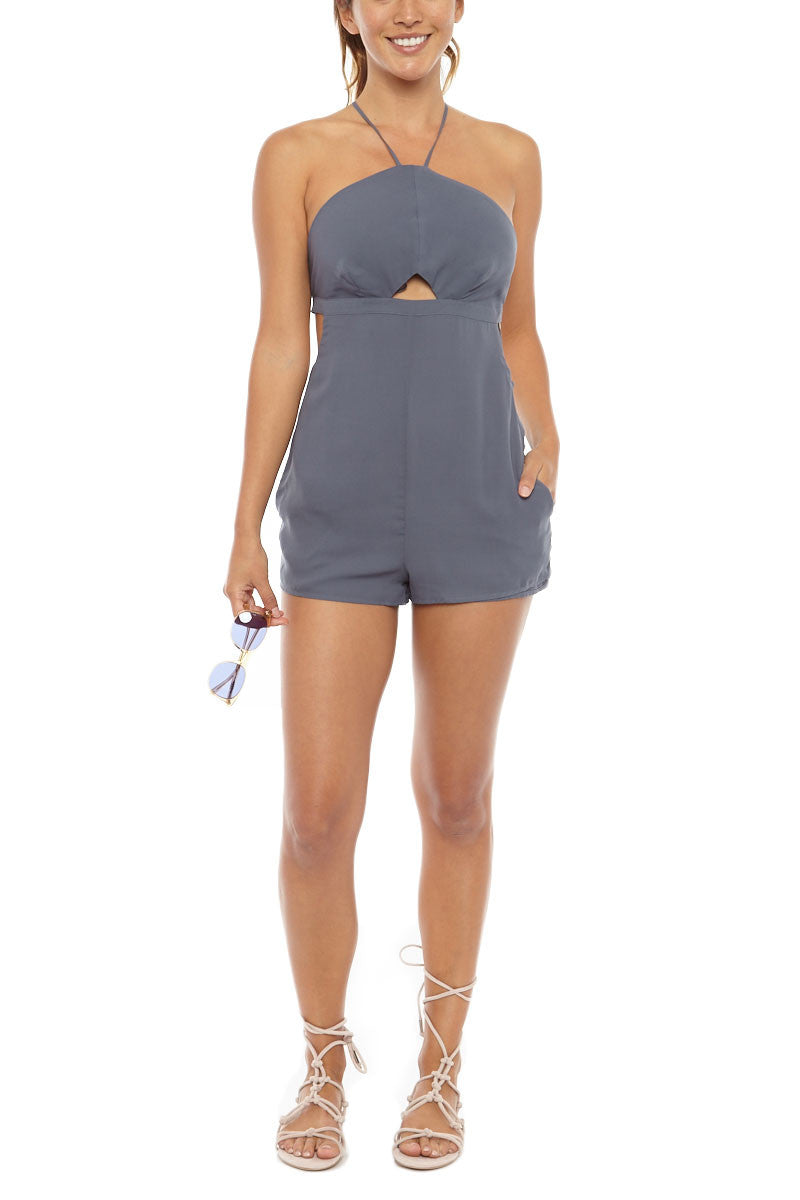 TAVIK Harlow Front Cut Out Playsuit - Ombre Blue Romper | Ombre Blue| Tavik Harlow Front Cut Out Playsuit - Ombre Blue Front cutout halter neck playsuit in grey-blue. Beautiful blue-grey fabric as a transitional tone that you can wear multiple seasons. Narrow neck with thin halter straps that crisscrosses at the back allows you to adjust the fit. Flirty front cutout detail and a back hook closure show off your skin. The short silhouette and side pockets create a perfect summertime outfit. Front View