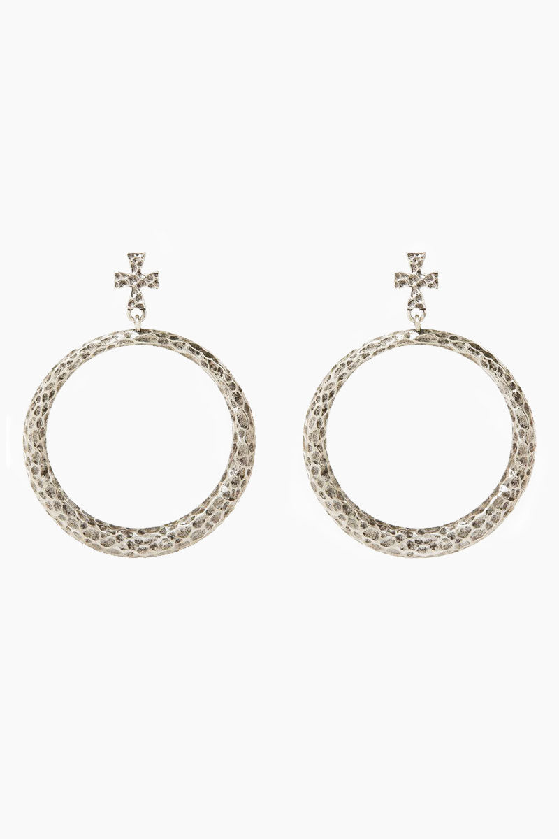 "LUV AJ The Hammered Cross Hoops - Silver Jewelry | Silver| Luv Aj The Hammered Cross Hoops - Silver. Features:  Pair of statement hoops with hammered texture and cross stud Posts are made from surgical steel so they are very hypo-allergenic Hoops are Approx. 3"" Tall Made from Brass Plated in Silver Front View"