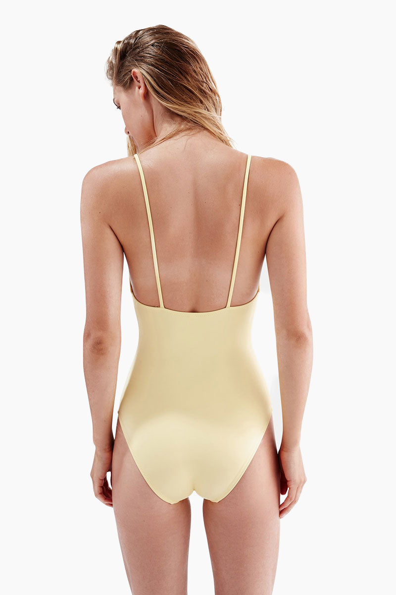 SOLID & STRIPED The Kelsey Cut Out One Piece Swimsuit - Pastel Yellow One Piece | Pastel Yellow| Solid & Striped The Kelsey Cut Out One Piece Swimsuit - Pastel Yellow.  FEATURES:  Self-lined to prevent sheerness Enamel flower charm Flattering keyhole cutout Full coverage bottom Made in Morocco Shell: 80% Polyester, 20% Elastane Lining: 80% Polyamide, 20% Elastane   CARE:  Hand wash in cold water, do not tumble dry.