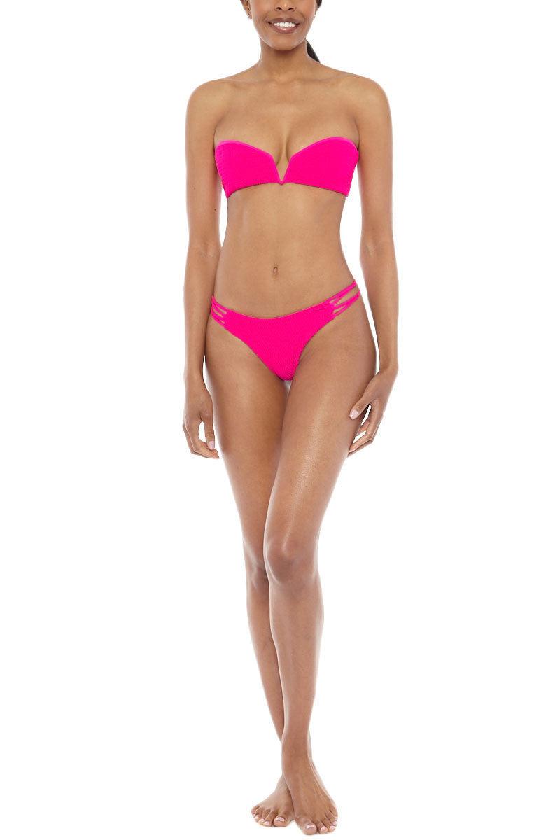 TORI PRAVER Nanda Strappy Sides Bikini Bottom - Pitaya Pink Bikini Bottom | Pitaya Pink| Tori Praver Nanda Strappy Sides Bikini Bottom - Pitaya Pink. Features:  Low rise Knotted string sides 80% Nylon / 20% Lycra Spandex Front View