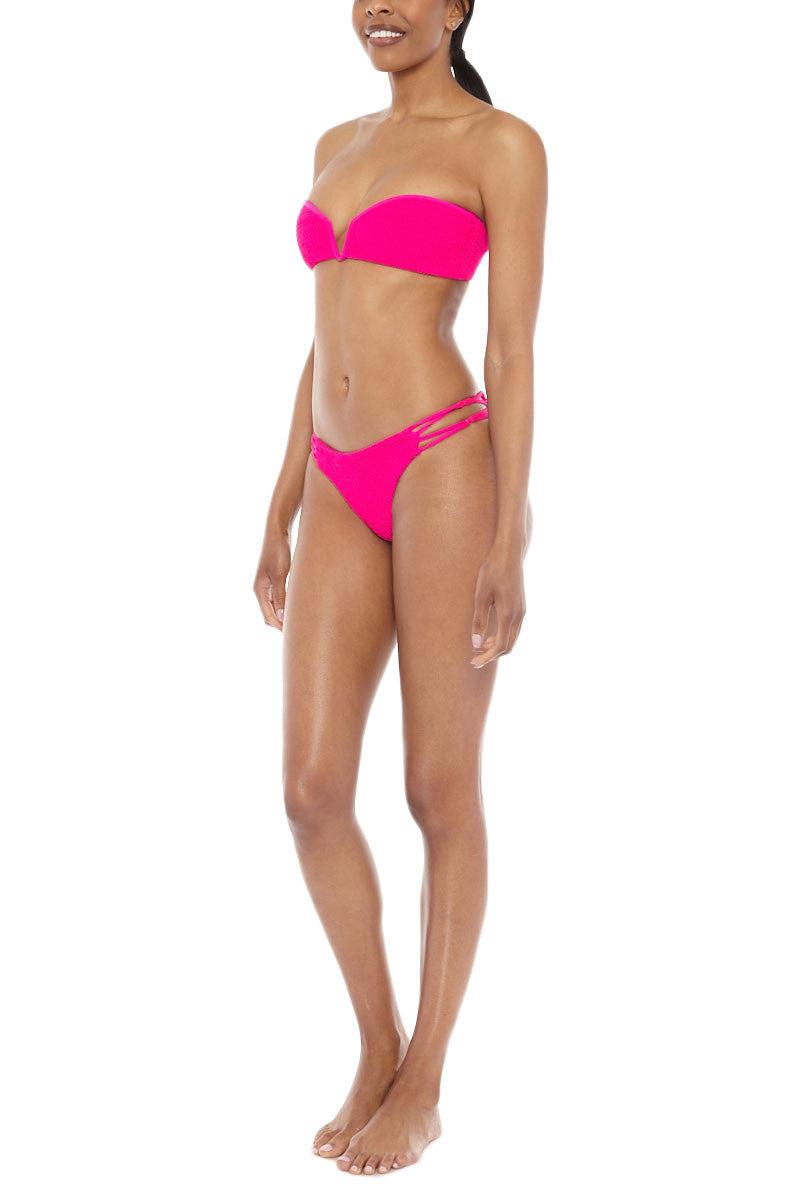 TORI PRAVER Nanda Strappy Sides Bikini Bottom - Pitaya Pink Bikini Bottom | Pitaya Pink| Tori Praver Nanda Strappy Sides Bikini Bottom - Pitaya Pink. Features:  Low rise Knotted string sides 80% Nylon / 20% Lycra Spandex Sides View