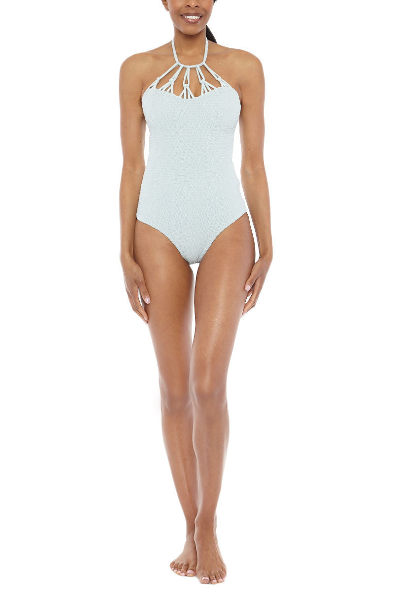 TORI PRAVER Magnolia High Neck Cut Out One Piece Swimsuit - Sage Green One Piece | Sage Green| Tori Praver Magnolia High Neck Cut Out One Piece Swimsuit - Sage Green High neckline with cut out detail Ties at neck Moderate to full coverage 80% Nylon, 20% Spandex Front View