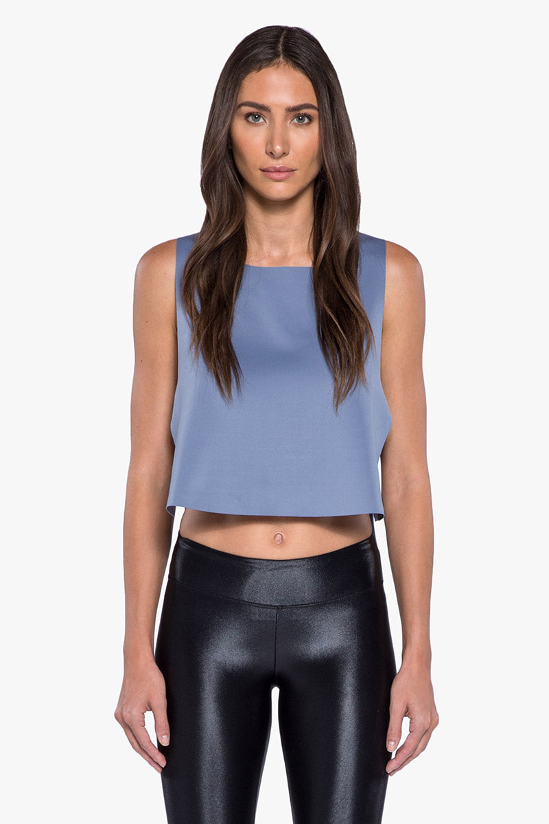KORAL Toss Crop Top - Nova Blue Top | Nova Blue| KORAL Toss Crop Top - Nova Blue. Features:  Raw edge, crop top with open sides and striped trim detail Meant for athleisure performance Machine wash cold, inside out with like colors; No bleach; Tmble dry low MADE IN USA Front View