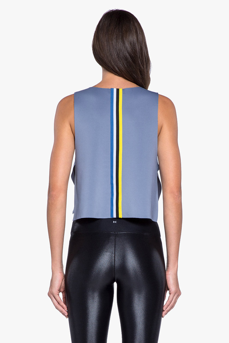 KORAL Toss Crop Top - Nova Blue Top | Nova Blue| KORAL Toss Crop Top - Nova Blue.. Features:  Raw edge, crop top with open sides and striped trim detail Meant for athleisure performance Machine wash cold, inside out with like colors; No bleach; Tmble dry low MADE IN USA Back View