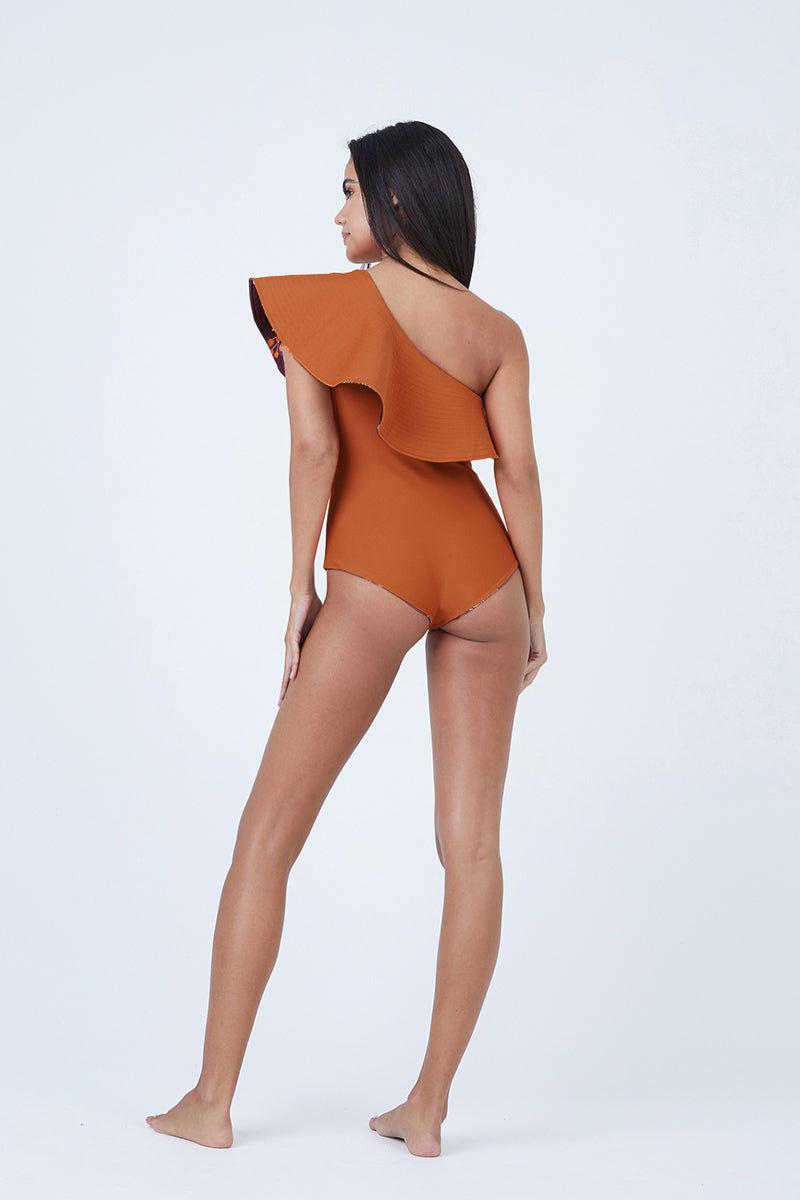 JUAN DE DIOS Tucan Reversible Ruffle One Shoulder One Piece Swimsuit - Dark Orange/Maroon One Piece   Dark Orange/Maroon  JUAN DE DIOS Tucan Reversible Ruffle One Shoulder One Piece Swimsuit - Dark Orange/Maroon. Features:  One shoulder one piece swimsuit Statement ruffles Reversible between Dark orange and Maroon Perfect for the beach and night out 80% Polyamide Front View