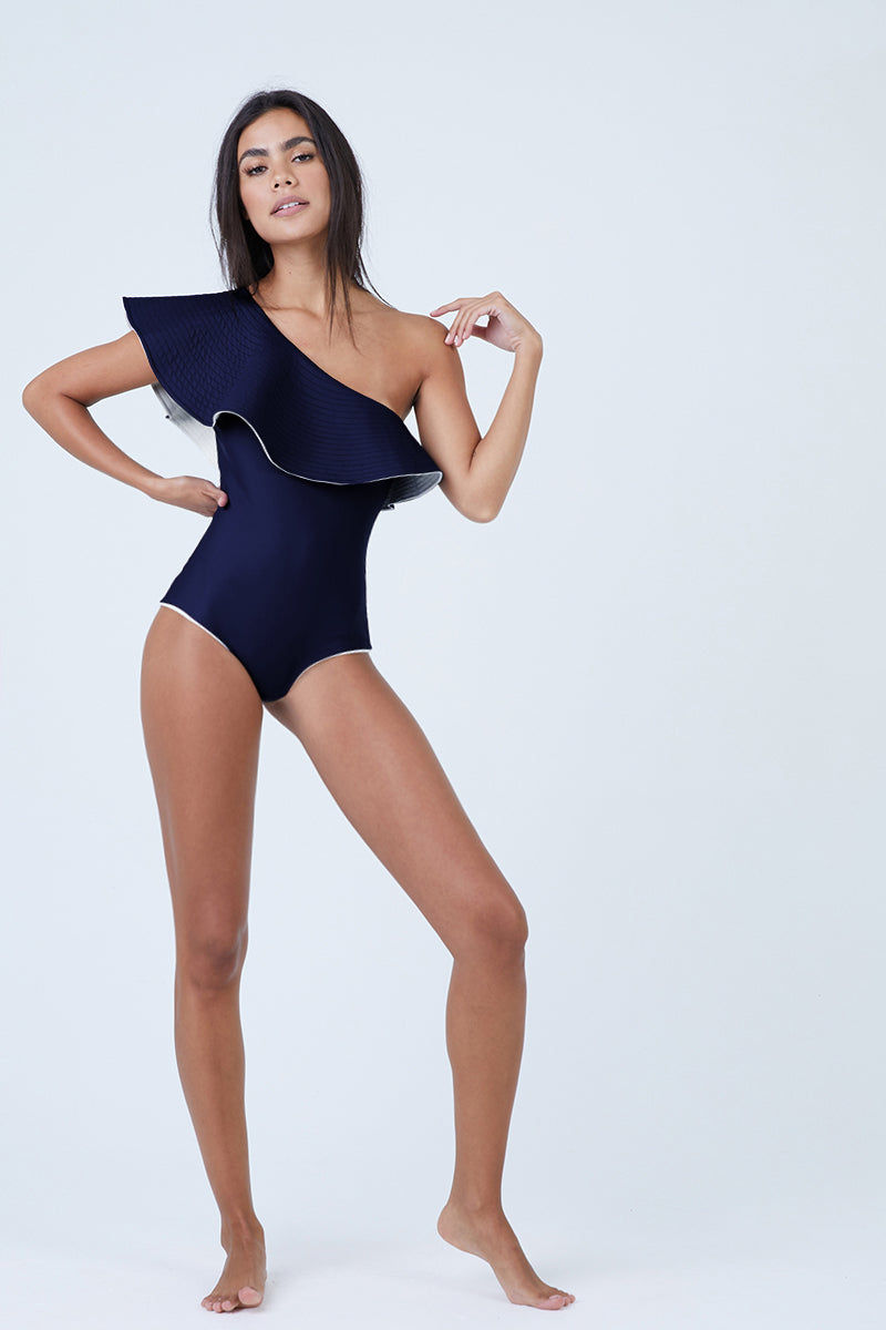 JUAN DE DIOS Tucan Reversible Ruffle One Shoulder One Piece Swimsuit - Navy/Ivory One Piece | Navy/Ivory|Juan De Dios Tucan Reversible Ruffle One Shoulder One Piece Swimsuit - One shoulder one piece swimsuit Statement ruffles Reversible between Navy and Ivory Cheeky coverage Perfect for the beach and night out