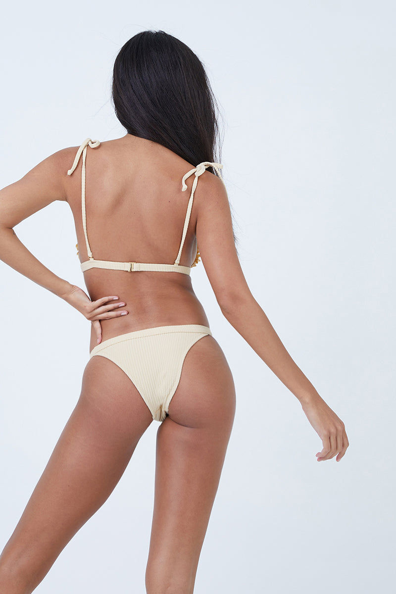 MADE BY DAWN Traveler Shoulder Tie Triangle Bikini Top - Blonde Rib Bikini Top | Blonde Rib| Made by Dawn Traveler Shoulder Tie Triangle Bikini Top - Blonde Rib. Features: Shoulder-tie triangle top Ruffle trim Back clasp in a tan ribbed jacquard fabric. 50% Mic-Nylon, 38% Nylon, 12% Spandex  Made in the USA Back View