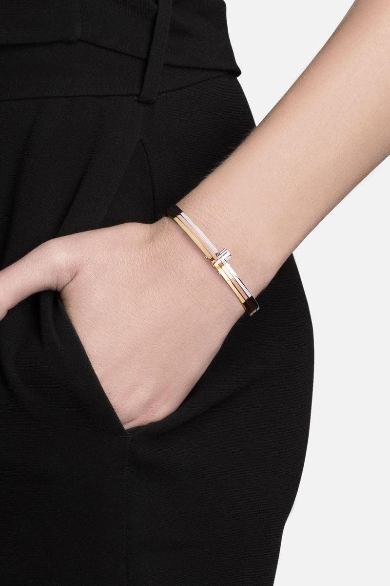 MIANSAI Tricolor Cuff - Gold Jewelry | Gold|Miansai Tricolor cuff on model view Timeless gold, rose, and silver tone cuff bracelet.