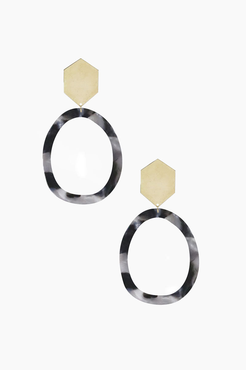 ETTIKA Tulum Hoops - Black & Gold Jewelry | Black & Gold| Ettika Tulum Hoops - Black & Gold Full View Dangling Earrings Hexagon Shaped Gold Detail Acrylic Black Hoop Detail 18kt Gold Plated Brass Length: 3.5 Inches
