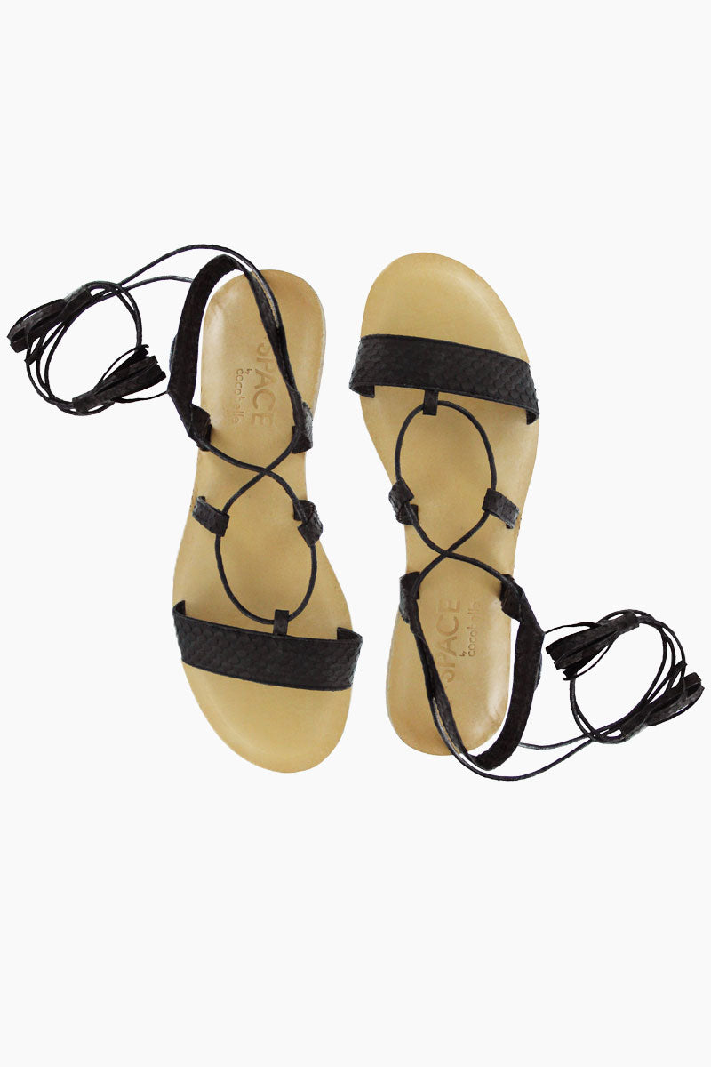 COCOBELLE Tulum Sandals - Black Sandals |  Black| Cocobelle Tulum Sandals -Features:  Ethically Sourced Snake-skin slide Ankle Wrap Tasseled Ties Leather/rubber Sole Front View