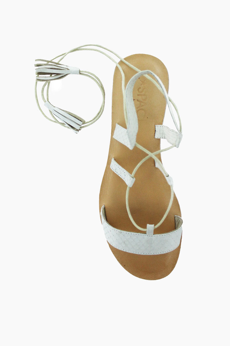 COCOBELLE Tulum Sandals - Ivory Sandals | White|  Cocobelle Tulum Sandals -Features:  Ethically Sourced Snake-skin slide Ankle Wrap Tasseled Ties Leather/rubber Sole Front View