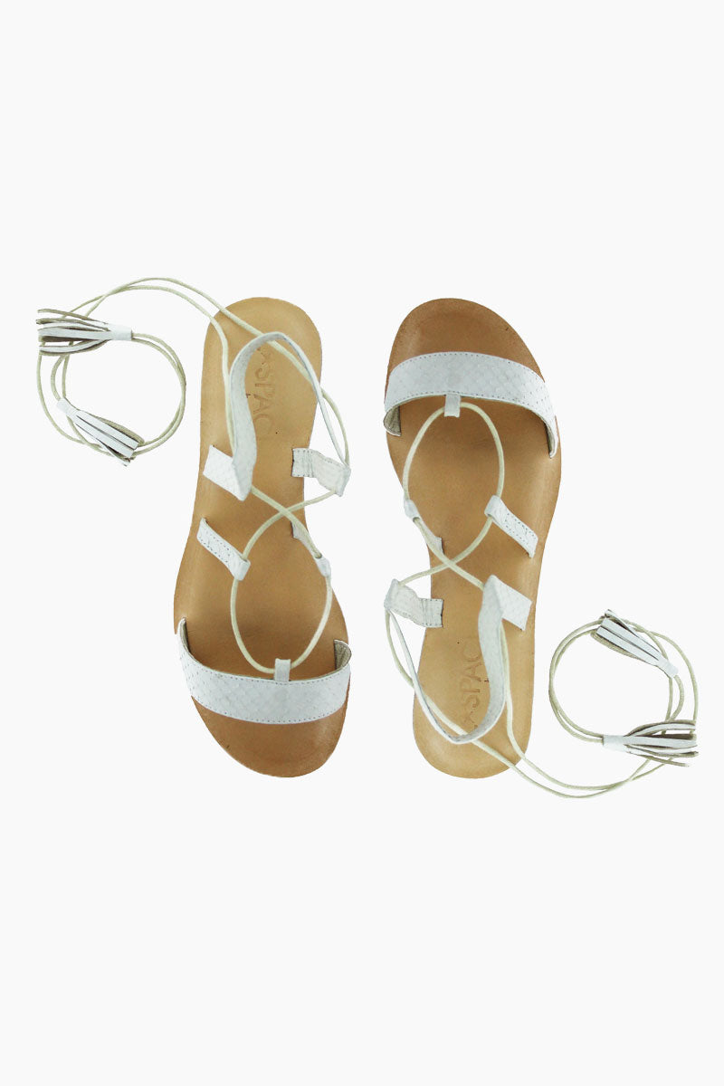 COCOBELLE Tulum Sandals - Ivory Sandals | Ivory|  Cocobelle Tulum Sandals -Features:  Ethically Sourced Snake-skin slide Ankle Wrap Tasseled Ties Leather/rubber Sole Front View