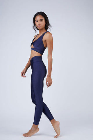 BEACH RIOT Aries High Rise V Waistband Yoga Leggings - Iridescent Navy Leggings | Iridescent Navy| Beach Riot Aries V Waistband Yoga Leggings - Iridescent Navy. Features: V Waistband Cut. High Waist. Sparkly Navy Fabric. View:  Side