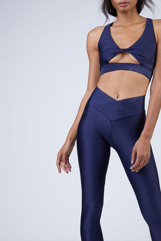 BEACH RIOT Aries High Rise V Waistband Yoga Leggings - Iridescent Navy Leggings | Iridescent Navy| Beach Riot Aries V Waistband Yoga Leggings - Iridescent Navy. Features: V Waistband Cut. High Waist. Sparkly Navy Fabric. View:  Front