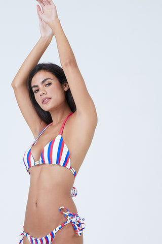AILA BLUE Conch Tie Side Bikini Bottom - Americana Stripe Bikini Bottom | Americana Stripe| Aila Blue Conch Tie Side Bikini Bottom - Americana Stripe Tie sides bikini bottom Can be worn cinched at the front and back for cheeky coverage or stretched out for more moderate coverage Front View
