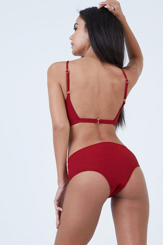 MADE BY DAWN Valley Mid Rise Bikini Bottom - Root Rib Bikini Bottom | Root Rib| Made by Dawn Valley Mid Rise Bikini Bottom - Root Rib. Features:   Red ribbed jacquard fabric. Wide side bottom  Full coverage  50% Micro-Nylon, 38% Nylon, 12% Spandex Made in the USA Back View