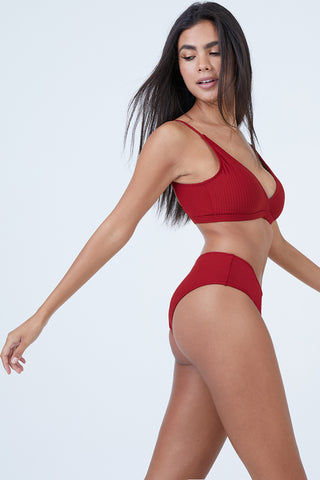 MADE BY DAWN Valley Mid Rise Bikini Bottom - Root Rib Bikini Bottom | Root Rib| Made by Dawn Valley Mid Rise Bikini Bottom - Root Rib. Features:   Red ribbed jacquard fabric. Wide side bottom  Full coverage  50% Micro-Nylon, 38% Nylon, 12% Spandex Made in the USA Front View