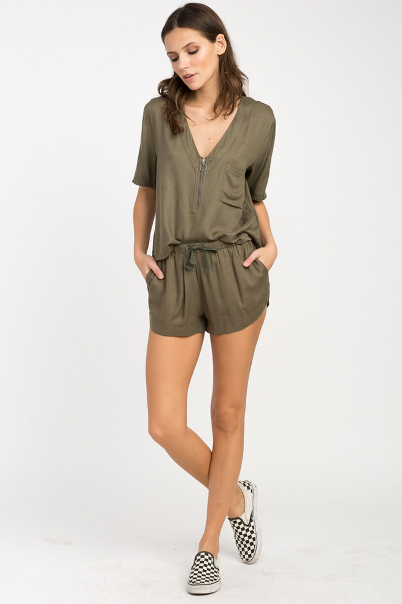 RVCA Vary Yume Elastic Shorts - Burnt Olive Shorts | Burnt Olive | RVCA Vary Yume Elastic Shorts - Burnt Olive Features:   Woven soft shorts Mid-rise silhouette Elastic waistband with a drawcord closure for the perfect fi Scalloped hemline On seam side pockets 100% rayon Front View