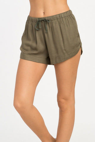 RVCA Vary Yume Elastic Shorts - Burnt Olive Shorts | Burnt Olive | RVCA Vary Yume Elastic Shorts - Burnt Olive Features:   Woven soft shorts Mid-rise silhouette Elastic waistband with a drawcord closure for the perfect fi Scalloped hemline On seam side pockets 100% rayon Side View