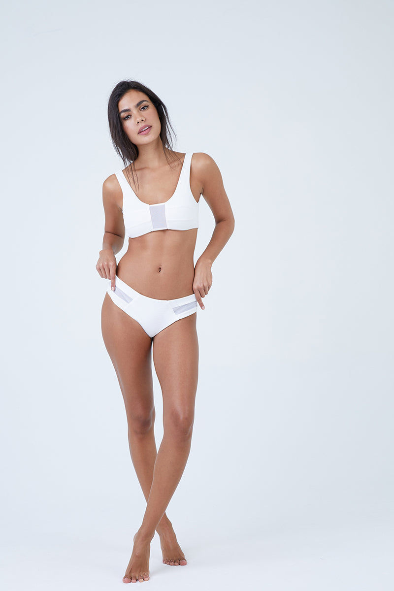 AILA BLUE Ellis Mesh Sides Bikini Bottom - White Waffle Bikini Bottom | White Waffle| Aila Blue Ellis Mesh Sides Bikini Bottom - White Waffle Mid Rise Wide Sides Straps Mesh Side Detail  Cheeky Coverage  Front View