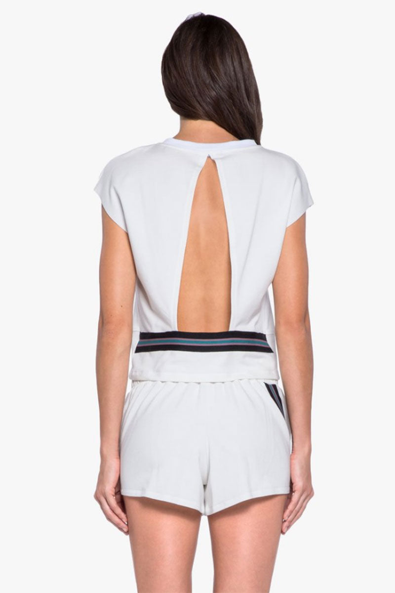 KORAL Watch Open Back Top - White Top | White| Koral Watch Open Back Top - White. Features:  Open back top with strip trim detail.  Meant for Athleisure performance. Fabric: French Terry - 48% Modal, 47% Cotton, 5% Spandex  Machine wash cold, inside out with like colors; No bleach; Tumble dry low. inside out with like colors; No bleach; Tumble dry low. MADE IN USA Back View