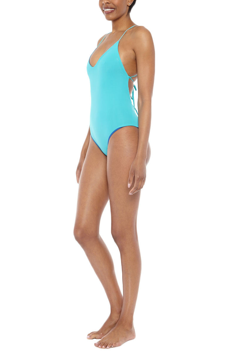 WATER GLAMOUR Chloe Reversible Criss Cross Back One Piece Swimsuit - Royal Blue/Turquoise Blue One Piece | Royal Blue/Turquoise Blue|Water Glamour  Chloe Reversible Criss Cross Back One Piece Swimsuit - Royal Blue/Turquoise Blue Low cut front Halter at top and ties in back Modest coverage 80% Nylon, 20% Spandex Side View