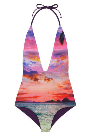 WATER GLAMOUR Reversible Deep V Halter One Piece Swimsuit - Sunset Tropical Print/Aubergine Purple One Piece | Sunset Tropical Print/Aubergine Purple| Water Glamour Reversible Deep V Halter One Piece Swimsuit - Sunset Tropical Print/Aubergine Purple Plunging v-neckline Reversible Adjustable Low cut back, scrunch butt 80% Nylon, 20% Lycra Spandex Front View