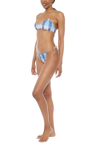 WATER GLAMOUR Jayne Reversible Braided Tie Side Ruched Bikini Bottom - Electric Blue Tie Dye Print/Nude Bikini Bottom | Electric Blue Tie Dye Print/Nude| Water Glamour Jayne Reversible Braided Tie Side Ruched Bikini Bottom - Electric Blue Tie Dye Print/Nude Reversible Adjustable ties at sides Ruched detail at back 80% Nylon, 20% Spandex Side View