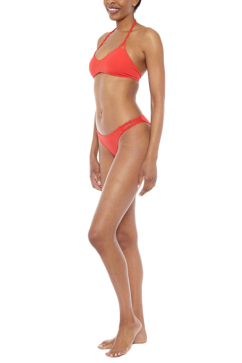 WATER GLAMOUR Knotted Ruched Bikini Bottom - Hot Coral Red Bikini Bottom   Hot Coral Red  Water Glamour Knotted Ruched Bikini Bottom - Hot Coral Red Cheeky coverage Scrunch butt Macrame side details 80% Nylon, 20% Lycra Spandex Side View