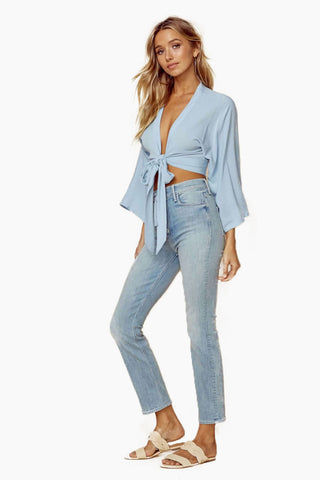 BLUE LIFE Wrapped Top - Denim Crinkle Top | Denim Crinkle| Blue Life Wrapped Top - Denim Crinkle. Features:  Deep V front Wrap style bodice Front tie closure Long kimono sleeves Made in USA Dry Clean Only 100% Rayon Side View