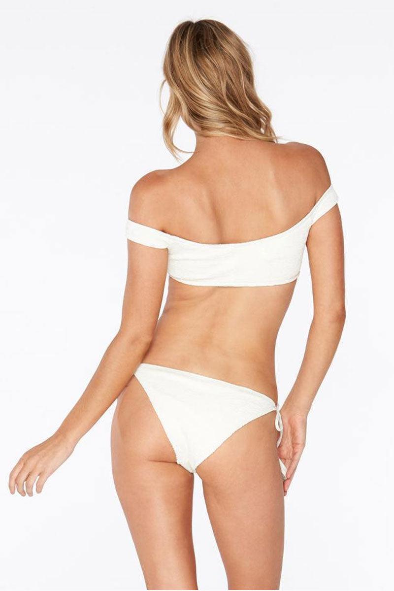 L SPACE Lily Tie Side Bikini Bottom - Cream White Bikini Bottom | Cream White | L Space Lily Tie Side Bikini Bottom - Cream White Low-rise tie side skimpy bikini bottom in cream. Ties at the sides are adjustable Back View