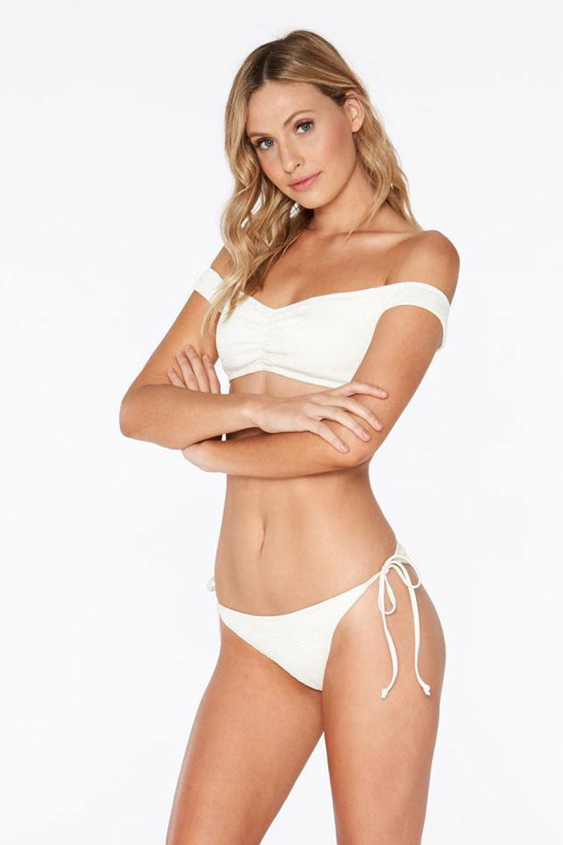 L SPACE Lily Tie Side Bikini Bottom - Cream White Bikini Bottom | Cream White| L Space Lily Tie Side Bikini Bottom - Cream White Low-rise tie side skimpy bikini bottom in cream. Ties at the sides are adjustable Front View