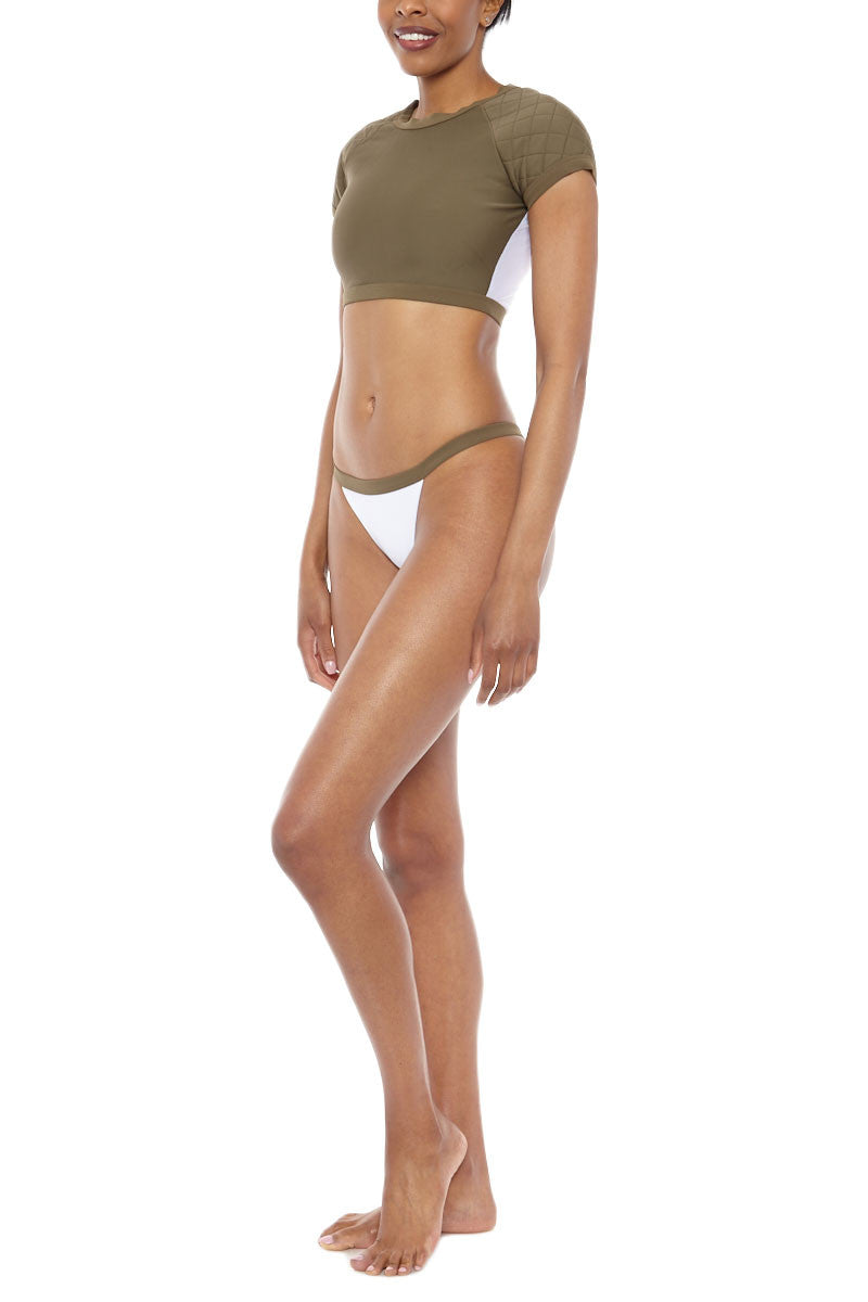 ZIGILANE Soldier Boy Crop Bikini Top - Olive Green Bikini Top | Olive Green| Zigilane Soldier Boy Crop Bikini Top - Olive Green Quilted shoulder detail Thick, lined fabric Zipper along back Crop top appropriate for swim or leisure  No padding Sheer material at back 72% Microfiber Nylon, 28% Spandex Side View