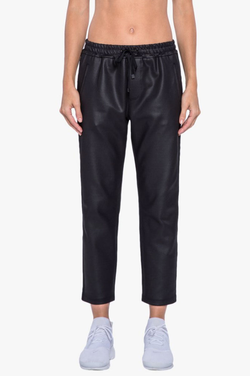 KORAL Zone Pants - Black Pants | Black| Koral Zone Pants - Black. Features:  Relaxed fit Cropped sweatpant with logo  Elastic side panels Athleisure performance Made in USA Front View