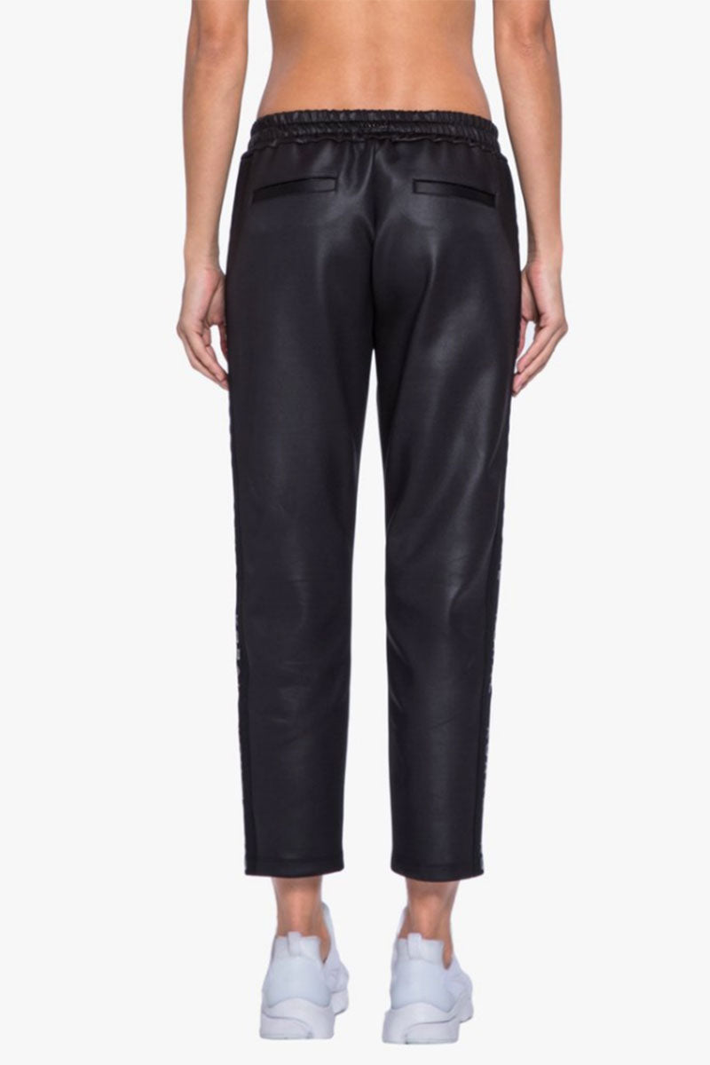 KORAL Zone Pants - Black Pants   Black  Koral Zone Pants - Black. Features:  Relaxed fit Cropped sweatpant with logo  Elastic side panels Athleisure performance Made in USA Back View