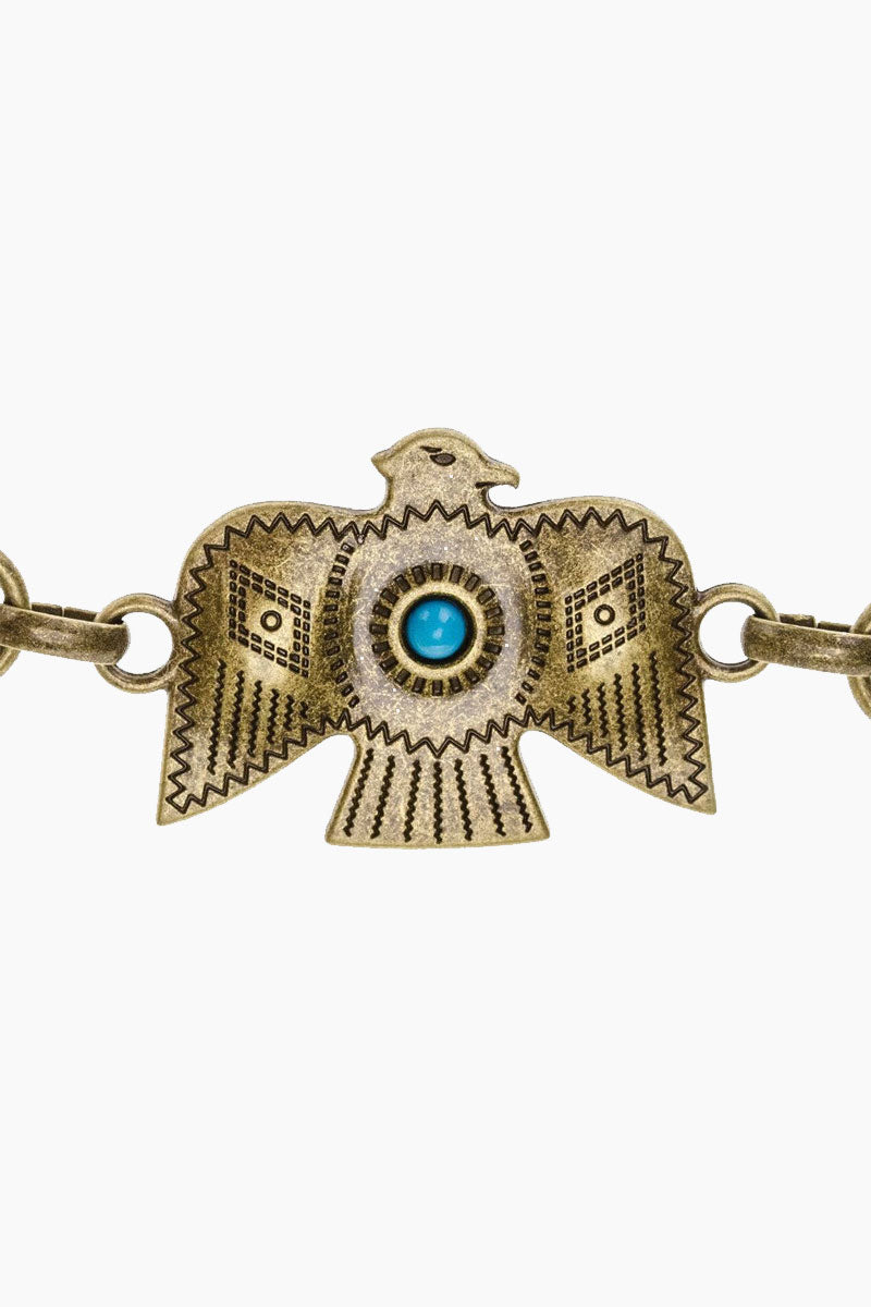 LOVESTRENGTH Zuni Metal Belt - Gold Accessories   Gold  Love Strength Zuni Metal Belt - Gold. Features:  Antique brass thunderbird conchos and turquoise stones Import Front View