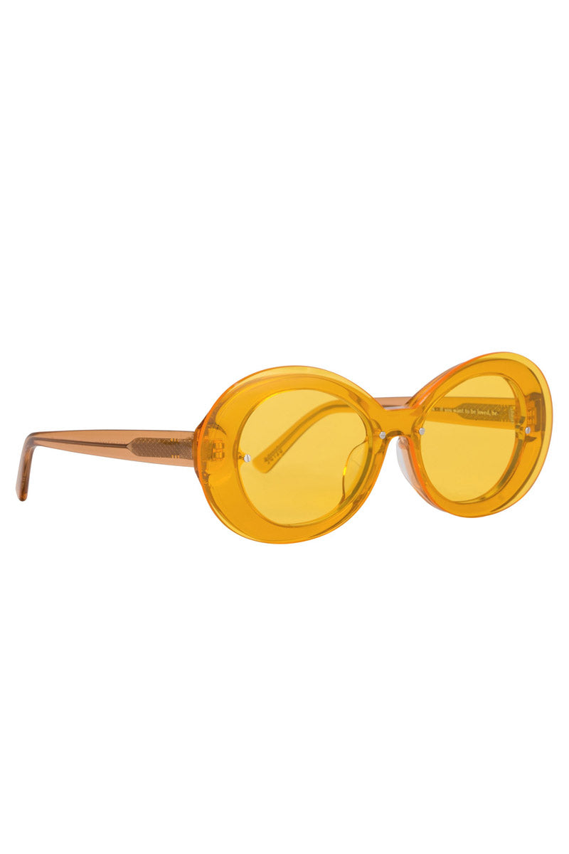 BONNIE CLYDE The Ai-Ren Sunglasses - Daffodillionaire Yellow Sunglasses | Daffodillionaire Yellow| Front Angled View of Bonnie Clyde Ai-Ren Sunglasses in Daffodillionaire Yellow .This style goes particularly well with Heart, Square, Oval, & Oblong faces. Features: Oversize Lens  Lens Type: Grade A Nylon Fit Size: Small-Medium  Frame Color: Clear Yellow Lens Color: Yellow Tint Unisexual   100% UV Protection   Glare reduction   Scratch-resistant coating Made from Stainless Steel & Acetate