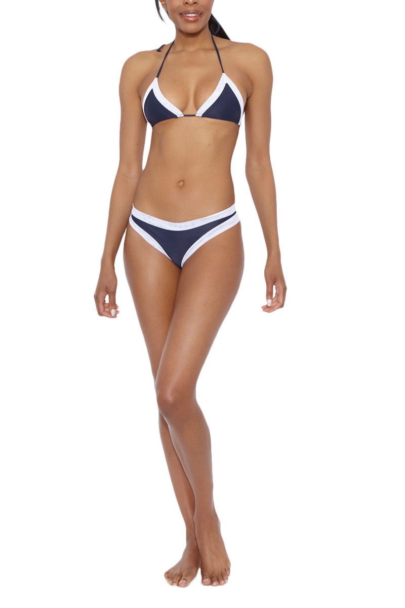 AILA BLUE Christopher Mesh Color Block Cheeky Bikini Bottom - Ink Blue & White Bikini Bottom | Ink Blue & White | Aila Blue Christopher Mesh Color Block Cheeky Bikini Bottom - Ink Blue & White Mesh Border. Cheeky Coverage. Low Rise. Front View