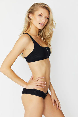 FRANKIES BIKINIS Alana Top - Black Bikini Top | Black| Alana Top Side View Black Henley Inspired Bikini Top Rose Gold Button Front Detail Luxe Ribbed Stretch Fit Fabric Adjustable Wide Shoulder Straps Thin Back Band Bra Hook Closure