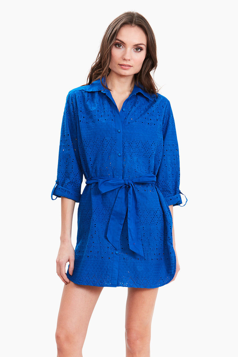 "AMITA NAITHANI Signature Eyelet Big Shirt Dress - Blue Dress | Blue| Amita Naithani Signature Eyelet Big Shirt Dress - Blue. Features:  All Over Stripe Eyelet Button Front w/ Spread Collar  Pocket w/ Side Slit Dolphin Hem About 32"" from hips to hem  Imported 100% Cotton Machine Wash Front View"