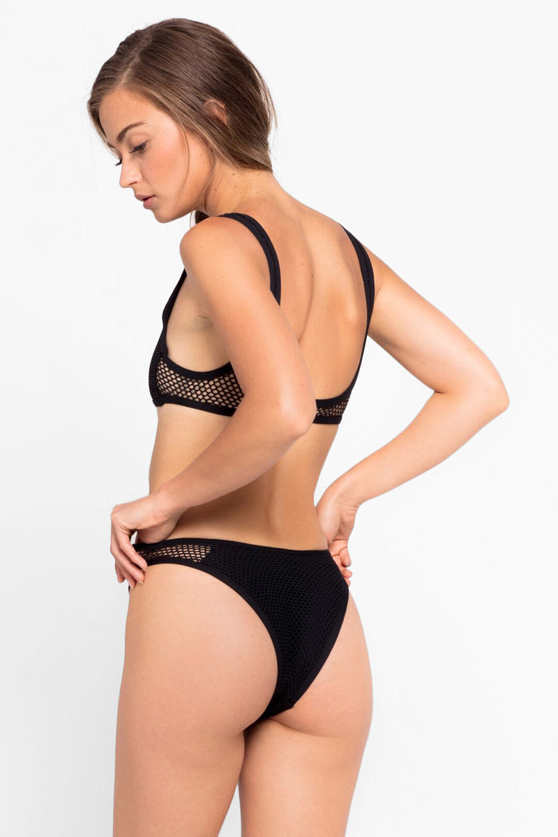 L SPACE Benji Mesh Bralette Bikini Top - Black Bikini Top | Black| L Space Benji Mesh Bralette Bikini Top - Black Scoop neckline Center cut out Cutout mesh designs Fixed shoulder straps Lined cups Pull over Back View