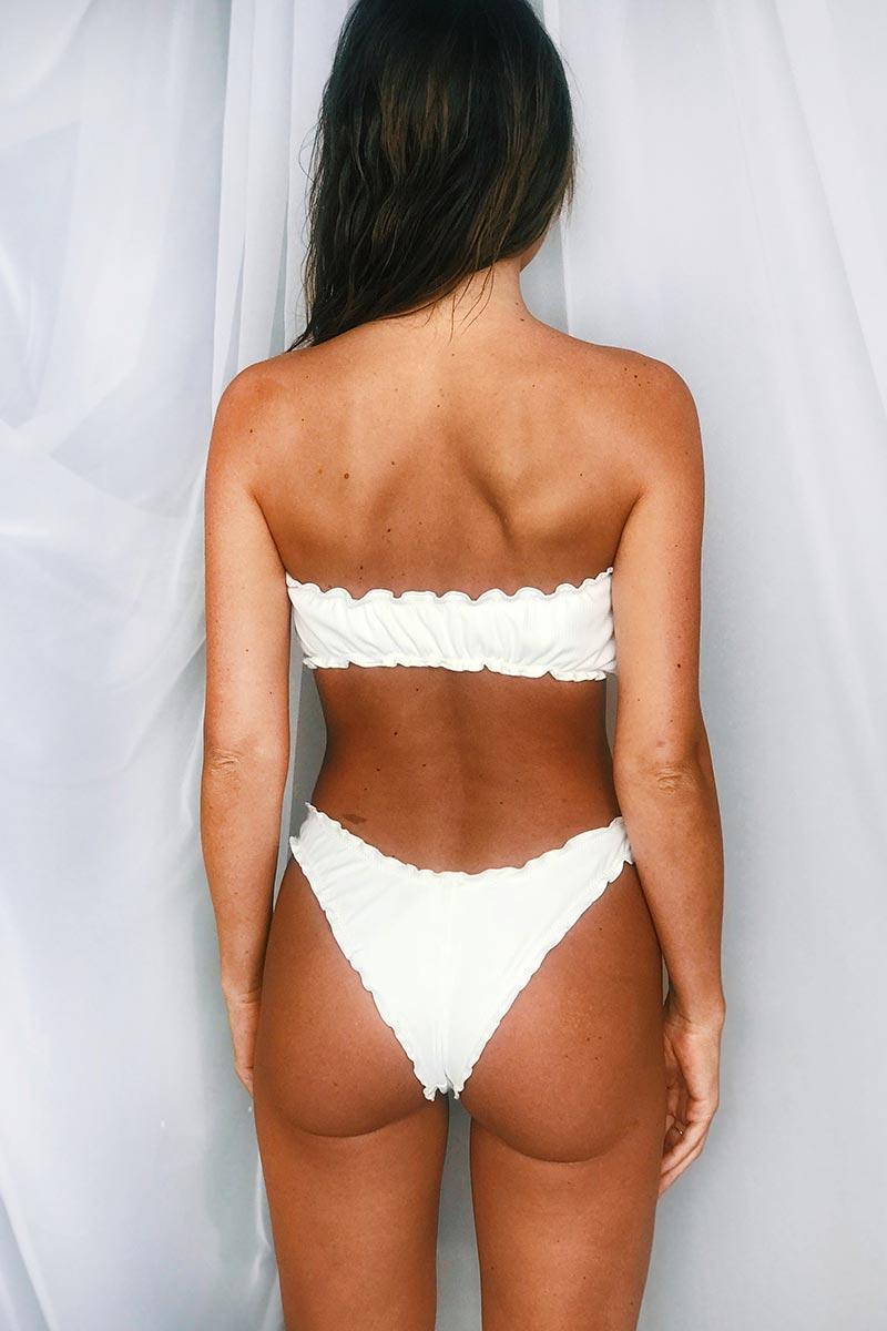 MGS 2019 Sugar Ruffle Bandeau Bikini Top - White Rib Bikini Top | White Rib| MGS 2019 Sugar Ruffle Bandeau Bikini Top - White Rib. Features:  Bandeau bikini top Ruffle edge Adjustable front tie Fabric Content:  Rib fabric Back View