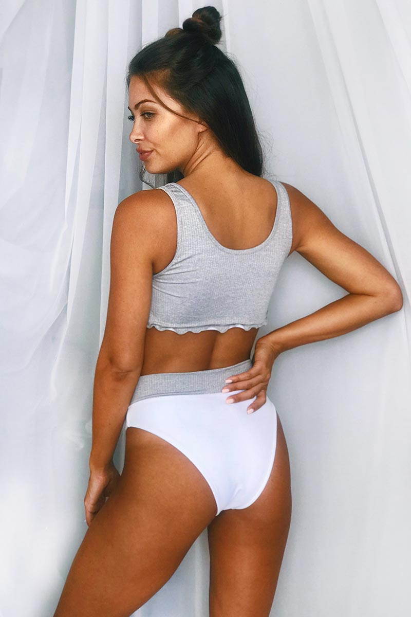 MGS 2019 Boyfriend Ribbed Crop Bikini Top - Heather Grey Bikini Top | Heather Grey| MGS 2019 Boyfriend Ribbed Crop Bikini Top - Heather Grey. Features:  Cropped ribbed crop bikini top Sporty style Heather grey ribbed fabric White lining Edge trim details Fabric content:  Lightweight Rib With Lycra Lining Front View