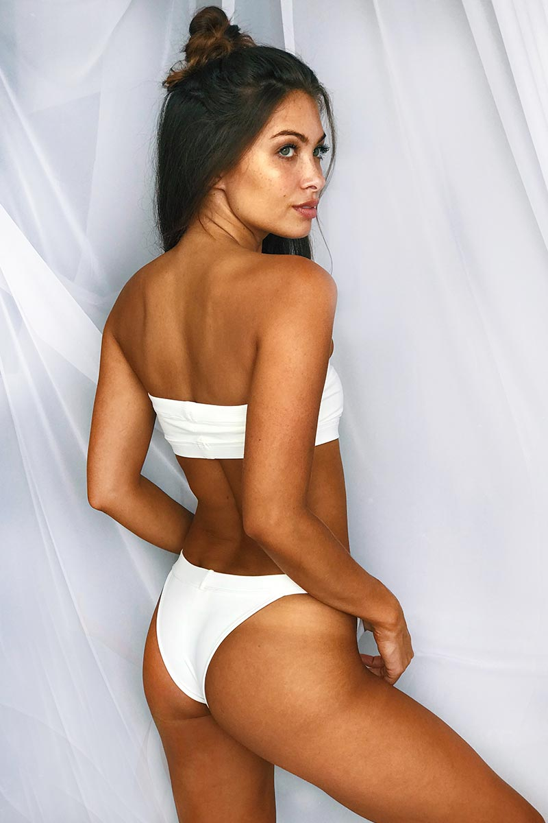 MGS 2019 Bubbles Cheeky Bikini Bottom - White Bikini Bottom | White | MGS 2019 Bubbles Cheeky Bikini Bottom - White. Features:  Banded rib basic bottom Cheeky coverage with Lycra Thick side straps High leg cut Fabric Content: Soft lycra with rib binding Back View