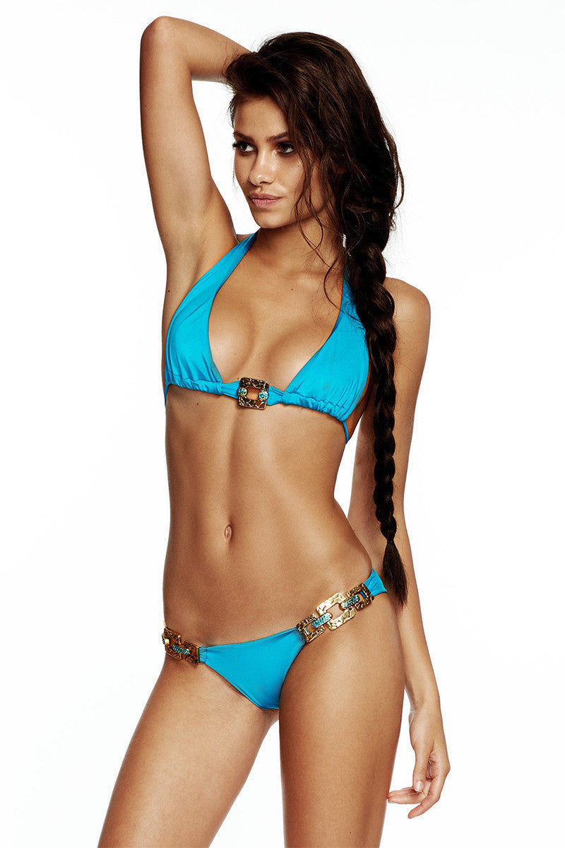 BEACH BUNNY Triple Crown Cheeky Low Rise Bikini Bottom - Capri Blue Bikini Bottom | Capri Blue| Triple Crown Cheeky Low Rise Bikini Bottom - Capri Blue. Front View. Cheeky Coverage. Low Rise Cut. Bronze hardaware detailing.