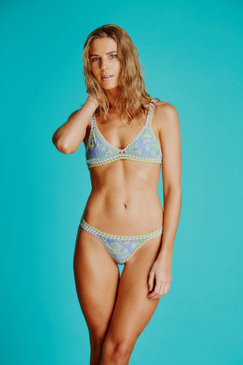 CAPITTANA Leonor Reversible Bikini Top Bikini Top | Spring Print| Capittana Leonor Reversible Bottom front view Vibrant tropical fruit print and laidback blue leaf print reversible bikini bottom with crochet trim.