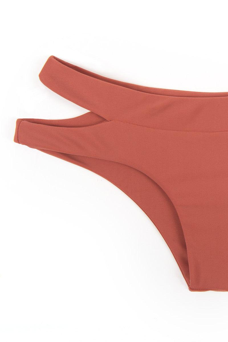 MIKOH Puka Puka Cut Out Cheeky Bikini Bottom - Lychee Pink Bikini Bottom | Lychee Pink| Mikoh Puka Puka Cut Out Cheeky Bikini Bottom - Lychee Pink. Features: Side cut out hipster bikini bottom cheeky coverage Front View