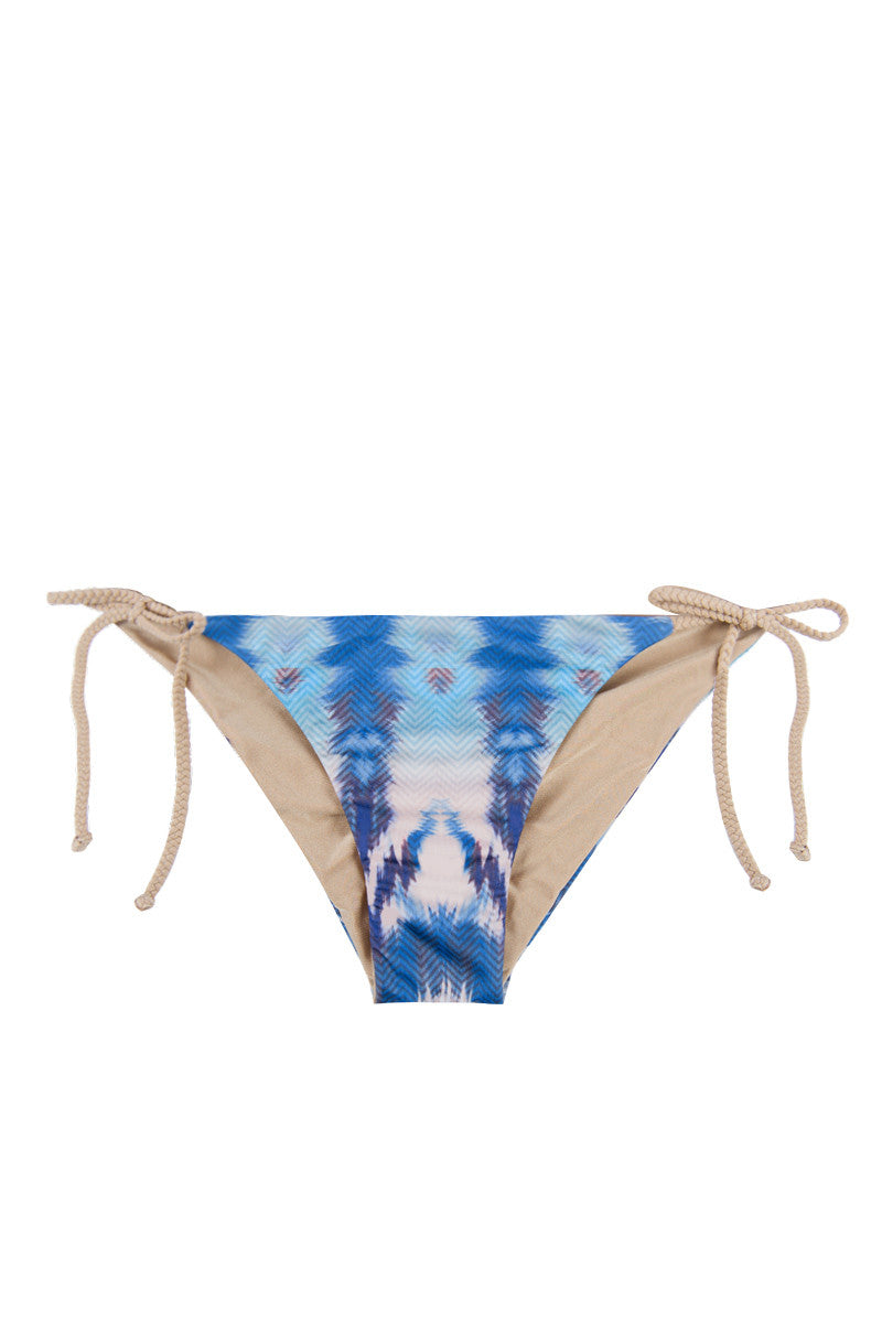 WATER GLAMOUR Jayne Reversible Braided Tie Side Ruched Bikini Bottom - Electric Blue Tie Dye Print/Nude Bikini Bottom | Electric Blue Tie Dye Print/Nude| Water Glamour Jayne Reversible Braided Tie Side Ruched Bikini Bottom - Electric Blue Tie Dye Print/Nude Reversible Adjustable ties at sides Ruched detail at back 80% Nylon, 20% Spandex Front View