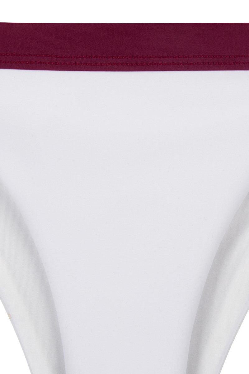 ZIGILANE Exclusive Color Block High Cut Bikini Bottom - White & Raspberry Red Bikini Bottom | White & Raspberry Red| Zigilane Exclusive Color Block High Cut Bikini Bottom - White & Raspberry Red High cut leg Color block Thick, lined fabric Cheeky coverage 72% Microfiber Nylon, 28% Spandex Front View